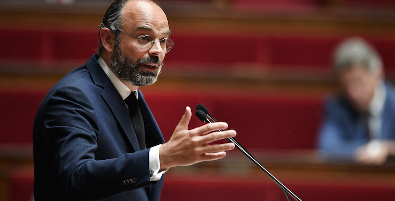 French Prime Minister Edouard Philippe presents his plan to exit from the lockdown at the National Assembly in Paris, Tuesday, April 28, 2020. French Prime Minister Edouard Philippe has outlined a stringent plan to fight coronavirus in France by automatically testing everyone who\'s come in contact with someone infected with COVID-19. (David Niviere, Pool via AP)